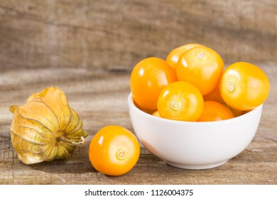 physalis (physalis, golden, gooseberry) isolated on wooden background - Physalis peruviana