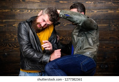 Physical attack. Men bearded hipster fighting. Attack and defence. Aggressive hooligan fighting with strong bully man. Street fight concept. Men brutal hooligans wear leather jackets fighting.