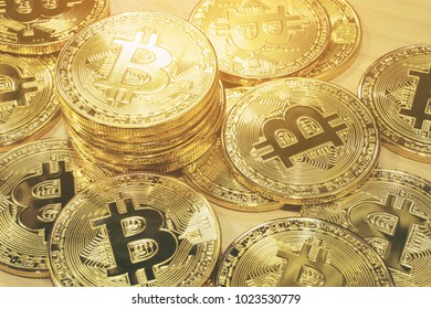 Physical Bitcoin pile background. Cryptocurrency trading concept.