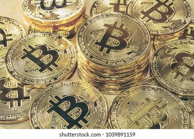 Physical Bitcoin pile background - Bitcoin mining business is the process of adding transaction records to Bitcoin public ledger of past transactions or blockchain. Cryptocurrency trading concept.