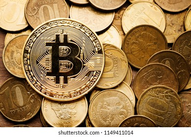 Physical bitcoins and roubles coins