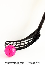 physical education and sport concept. sports games. black floorball stick and red ball isolated on white background. copy space for text.