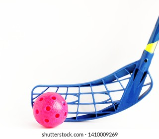physical education and sport concept. sports games. blue floorball stick and red ball isolated on white background. copy space for text.