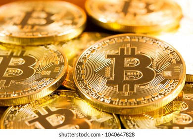 Physical Gold Bitcoin pile background - Bitcoin mining business is the process of adding transaction records to Bitcoin public ledger of past transactions or blockchain. Cryptocurrency trading concept
