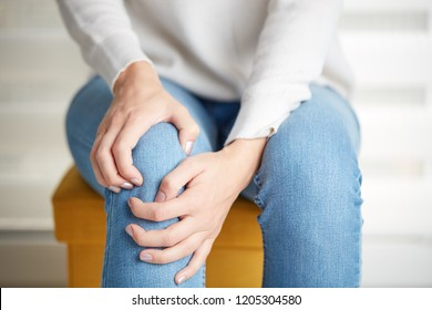 Physical injury of leg / knee / joint - woman holding painful part body.