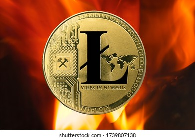 Physical Litecoin gold coin (LTC) with fire or flame background. Cryptocurrency bull market growth with rising prices.