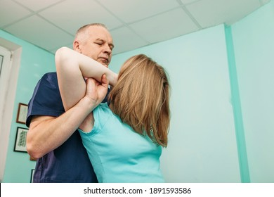 Physical rehabilitation therapies and treatment of physiological disorders by physiotherapists concept. Professional therapists are stretching muscles, patients with abnormal muscular symptoms.