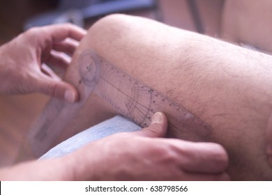 Physical therapy mecical clinic physiotherapy treatment measuring range of movement in patient after injury rehabilitation.
