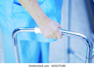 Physical therapy in rehab patient walking in walker at nursing hospital : healthy strong medical concept