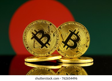 Physical version of Bitcoin and Bangladesh Flag. Close up.