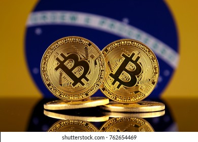 Physical version of Bitcoin and Brazil Flag. Close up.