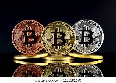 Physical version of Bitcoin (BTC). Conceptual image for investors in High Technology (Cryptocurrency, Blockchain Technology, Smart Contracts, ICO).