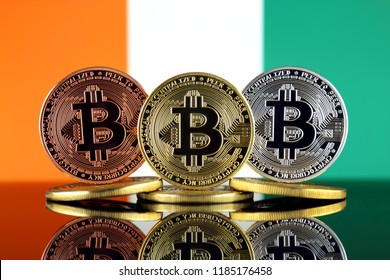 Physical version of Bitcoin (BTC) and Ivory Coast Flag. Conceptual image for investors in High Technology (Cryptocurrency, Blockchain Technology, Smart Contracts, ICO).