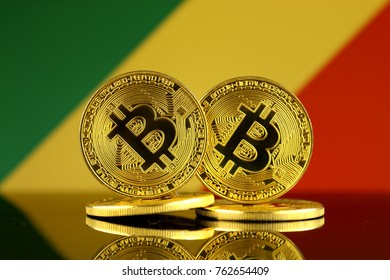 Physical version of Bitcoin and Congo Republic Flag. Close up.