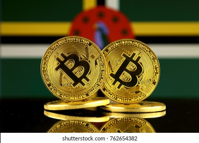 Physical version of Bitcoin and Dominica Flag. Close up.
