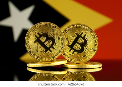 Physical version of Bitcoin and East Timor Flag. Close up.