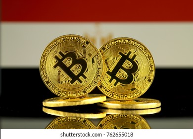 Physical version of Bitcoin and Egypt Flag. Close up.