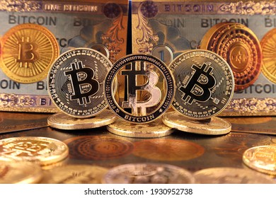 A physical version of Bitcoin in the form of coins and banknotes. A conceptual image for investors in the fast-growing cryptocurrency and blockchain technology market.