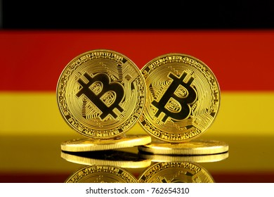 Physical version of Bitcoin and Germany Flag. Close up.