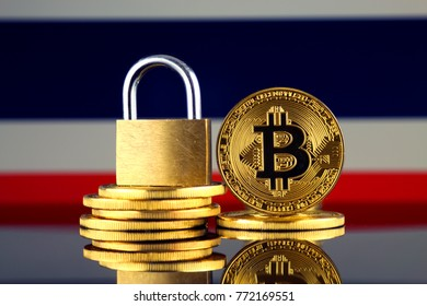 Physical version of Bitcoin, golden padlock and Thailand Flag. Prohibition of cryptocurrencies, regulations, restrictions or security, protection, privacy.