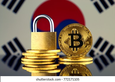 Physical version of Bitcoin, golden padlock and South Korea Flag. Prohibition of cryptocurrencies, regulations, restrictions or security, protection, privacy.