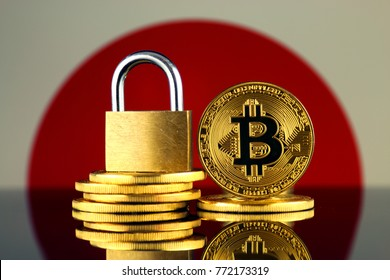 Physical version of Bitcoin, golden padlock and Japan Flag. Prohibition of cryptocurrencies, regulations, restrictions or security, protection, privacy.