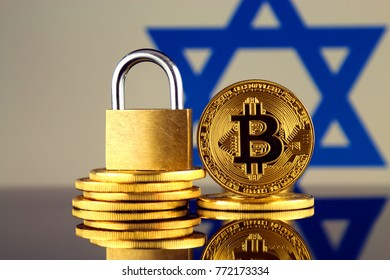 Physical version of Bitcoin, golden padlock and Israel Flag. Prohibition of cryptocurrencies, regulations, restrictions or security, protection, privacy.