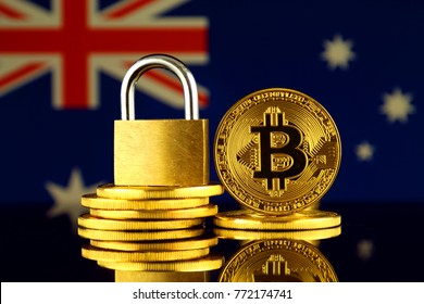 Physical version of Bitcoin, golden padlock and Australia Flag. Prohibition of cryptocurrencies, regulations, restrictions or security, protection, privacy.