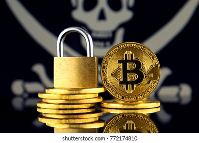 Physical version of Bitcoin, golden padlock and Pirate Flag. Prohibition of cryptocurrencies, regulations, restrictions or security, protection, privacy.