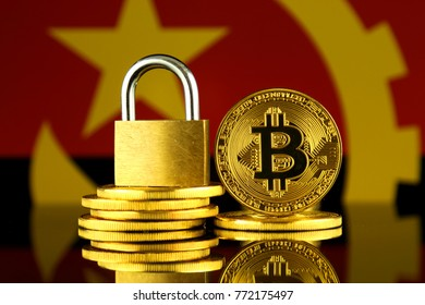 Physical version of Bitcoin, golden padlock and Angola Flag. Prohibition of cryptocurrencies, regulations, restrictions or security, protection, privacy.