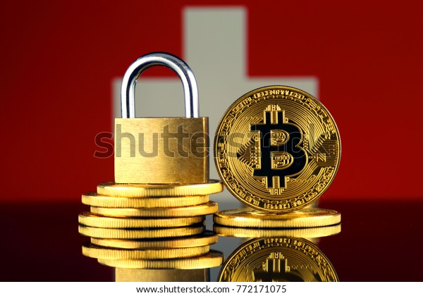 Physical version of Bitcoin, golden padlock and Switzerland Flag. Prohibition of cryptocurrencies, regulations, restrictions or security, protection, privacy.