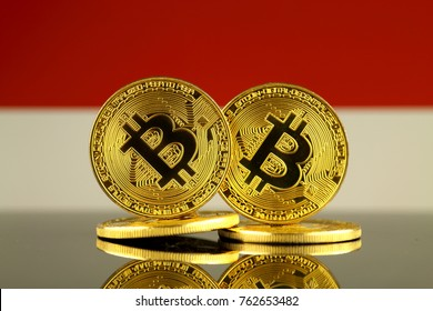 Physical version of Bitcoin and Indonesia Flag. Close up.