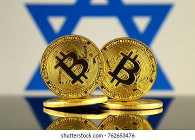 Physical version of Bitcoin and Israel Flag. Close up.