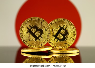 Physical version of Bitcoin and Japan Flag. Close up.
