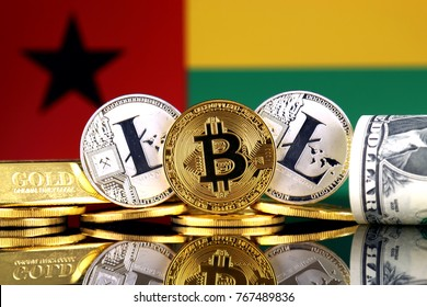 Physical version of Bitcoin, Litecoin, gold, US Dollar and Guinea Bissau Flag. Conceptual image for investors in cryptocurrency, gold and dollars.