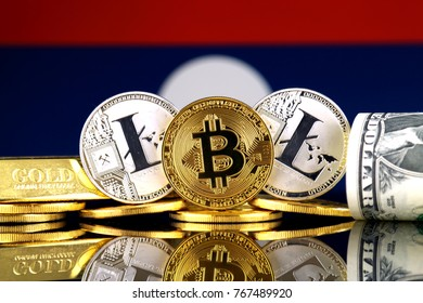 Physical version of Bitcoin, Litecoin, gold, US Dollar and Laos Flag. Conceptual image for investors in cryptocurrency, gold and dollars.