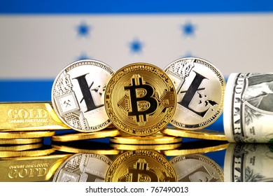 Physical version of Bitcoin, Litecoin, gold, US Dollar and Honduras Flag. Conceptual image for investors in cryptocurrency, gold and dollars.