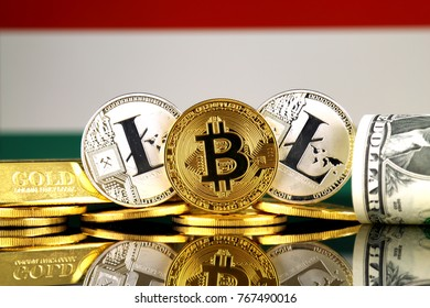Physical version of Bitcoin, Litecoin, gold, US Dollar and Hungary Flag. Conceptual image for investors in cryptocurrency, gold and dollars.