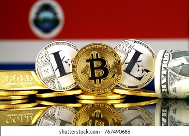 Physical version of Bitcoin, Litecoin, gold, US Dollar and Costa Rica Flag. Conceptual image for investors in cryptocurrency, gold and dollars.