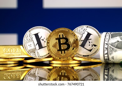 Physical version of Bitcoin, Litecoin, gold, US Dollar and Finland Flag. Conceptual image for investors in cryptocurrency, gold and dollars.