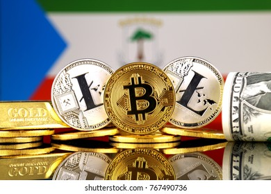 Physical version of Bitcoin, Litecoin, gold, US Dollar and Equatorial Guinea Flag. Conceptual image for investors in cryptocurrency, gold and dollars.
