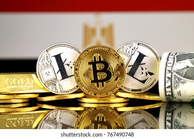 Physical version of Bitcoin, Litecoin, gold, US Dollar and Egypt Flag. Conceptual image for investors in cryptocurrency, gold and dollars.
