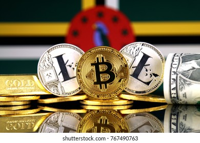 Physical version of Bitcoin, Litecoin, gold, US Dollar and Dominica Flag. Conceptual image for investors in cryptocurrency, gold and dollars.