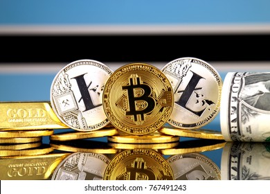 Physical version of Bitcoin, Litecoin, gold, US Dollar and Botswana Flag. Conceptual image for investors in cryptocurrency, gold and dollars.