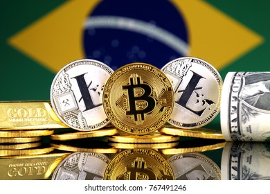 Physical version of Bitcoin, Litecoin, gold, US Dollar and Brazil Flag. Conceptual image for investors in cryptocurrency, gold and dollars.