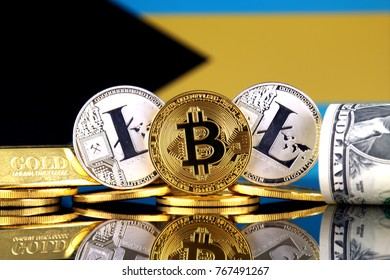 Physical version of Bitcoin, Litecoin, gold, US Dollar and Bahamas Flag. Conceptual image for investors in cryptocurrency, gold and dollars.
