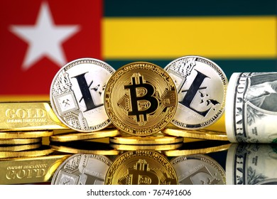 Physical version of Bitcoin, Litecoin, gold, US Dollar and Togo Flag. Conceptual image for investors in cryptocurrency, gold and dollars.