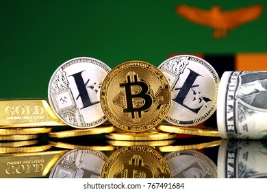 Physical version of Bitcoin, Litecoin, gold, US Dollar and Zambia Flag. Conceptual image for investors in cryptocurrency, gold and dollars.