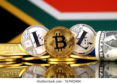 Physical version of Bitcoin, Litecoin, gold, US Dollar and South Africa Flag. Conceptual image for investors in cryptocurrency, gold and dollars.