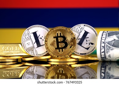 Physical version of Bitcoin, Litecoin, gold, US Dollar and Mauritius Flag. Conceptual image for investors in cryptocurrency, gold and dollars.